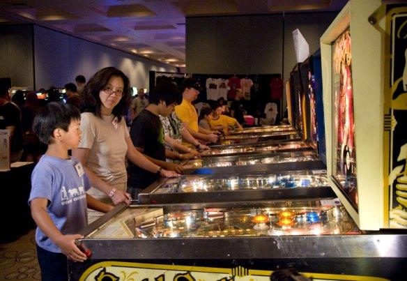 boy plays pinball vintage pinball machines california extreme eight ball
