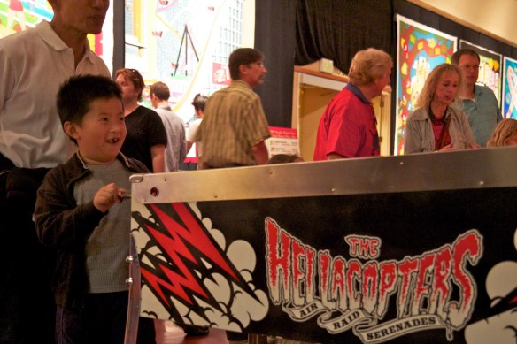 boy plays pinball machine pacific pinball expo 2011