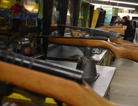 rifles along the shooting game row