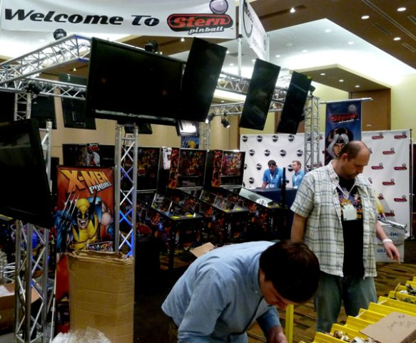 Setting up the show Stern Pinball booth